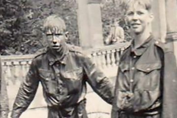 Peter and two friends having just completed the CCF assault course